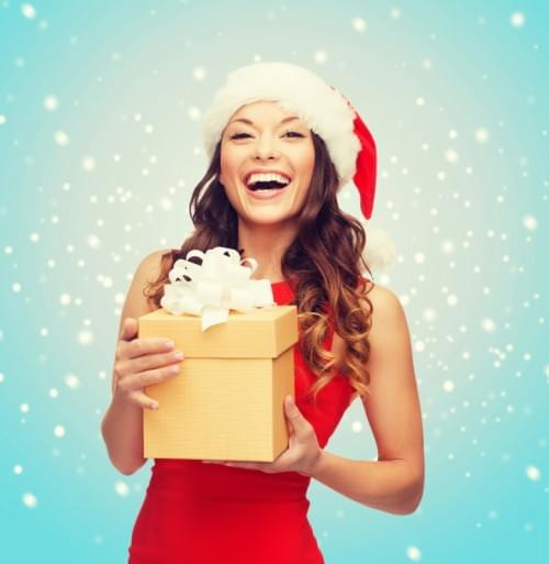 christmas, x-mas, new year, winter, happiness concept - smiling woman in santa helper hat with gift box