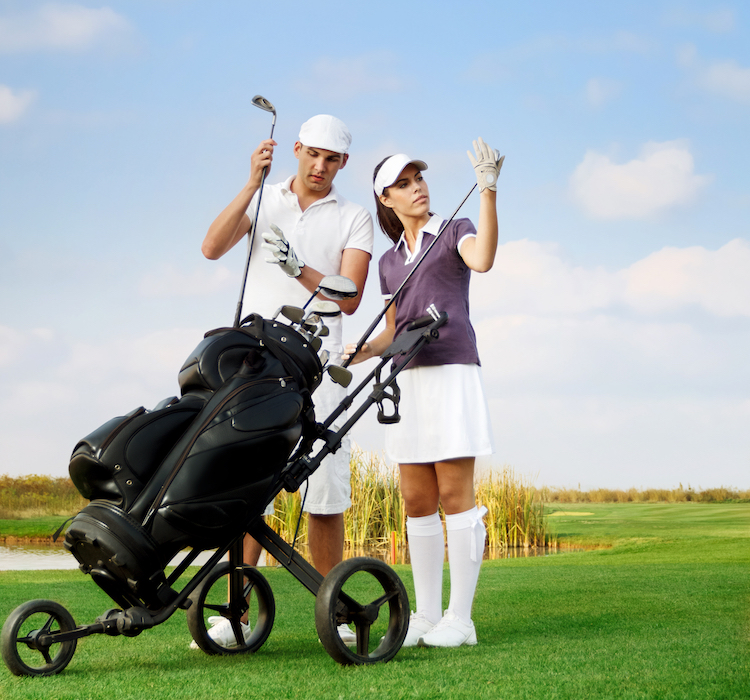 young couple playing golf at the club