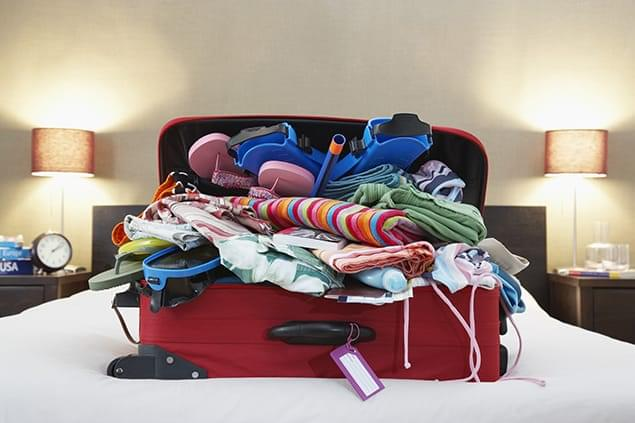 bigstock-Open-suitcase-on-bed-49203935