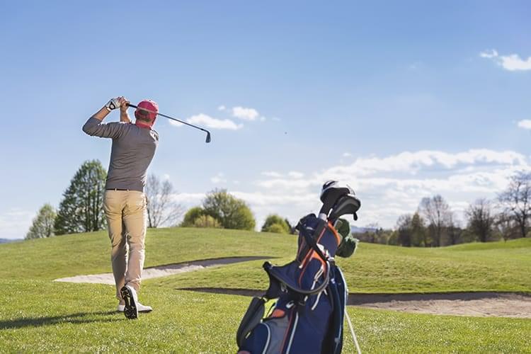 bigstock-Male-golf-player-swinging-golf-89927666